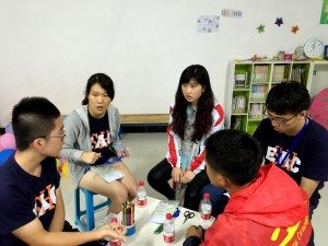 Group discussion on next day's activities to be conducted for school children 分組討論第二天將為學童進行的活動